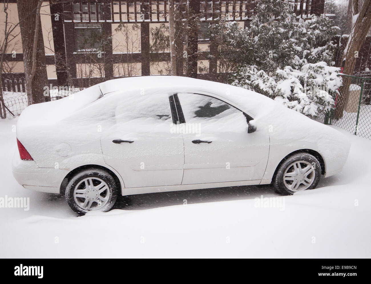Snowed in driveway after winter storm - Stock Image