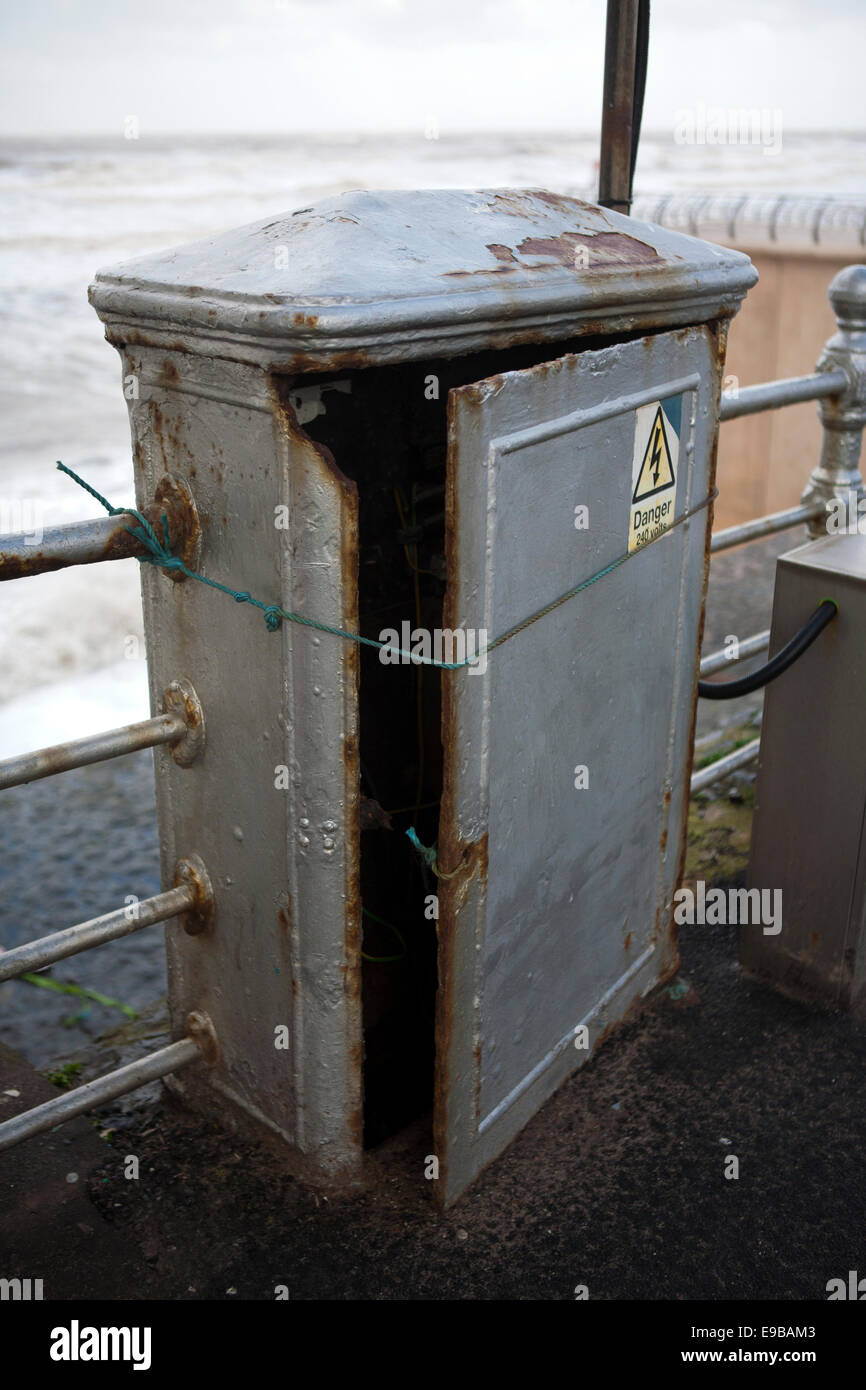 Tied up with string  Disused electrical box with open door, Blackpool, Promenade, Lancashire, UK Stock Photo