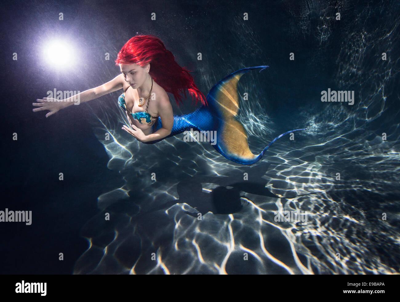 Redhead Mermaid In Pool In Stock Photos & Redhead Mermaid In Pool In