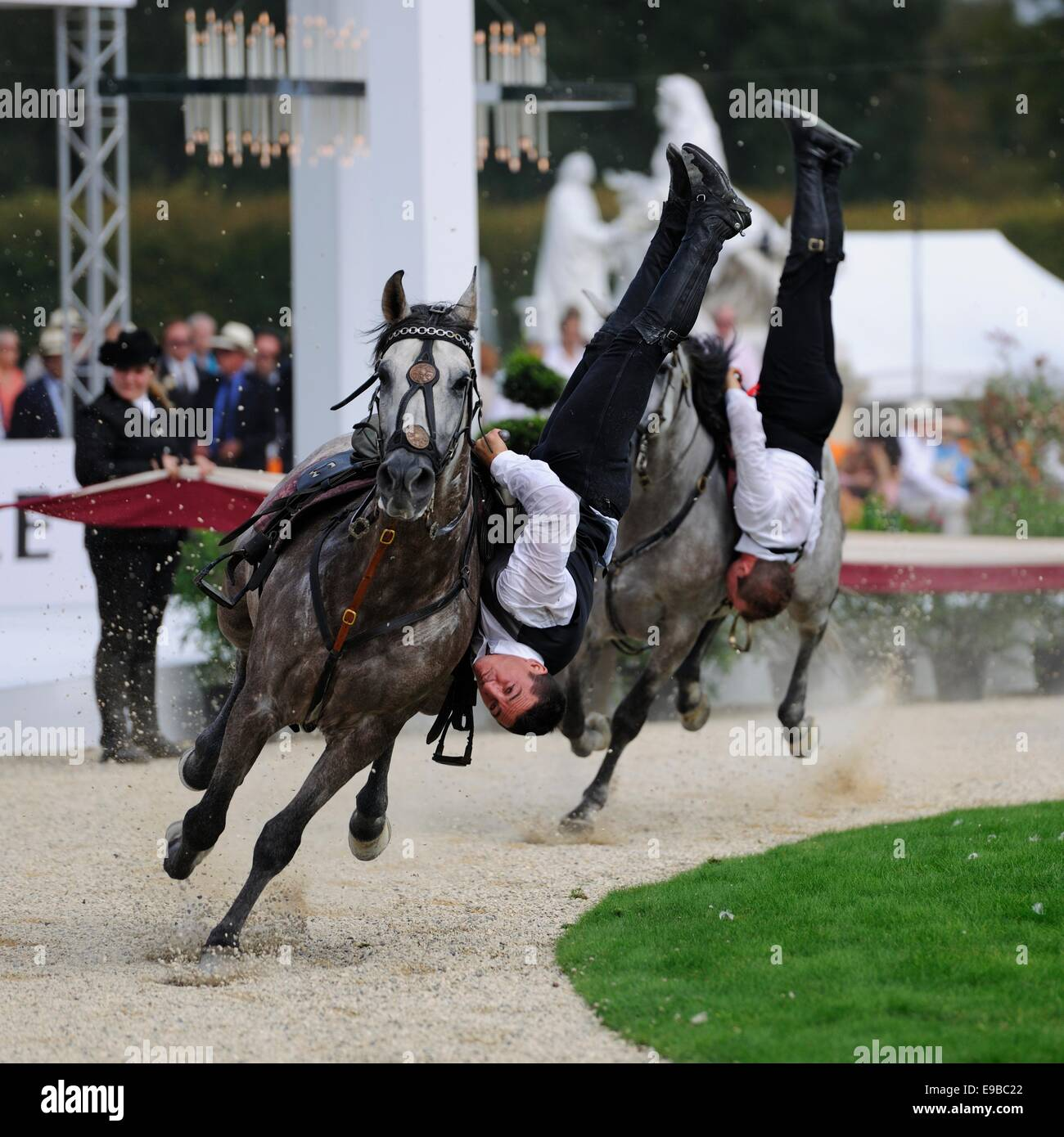 stunt horse riders performing at an outdoor event - Stock Image