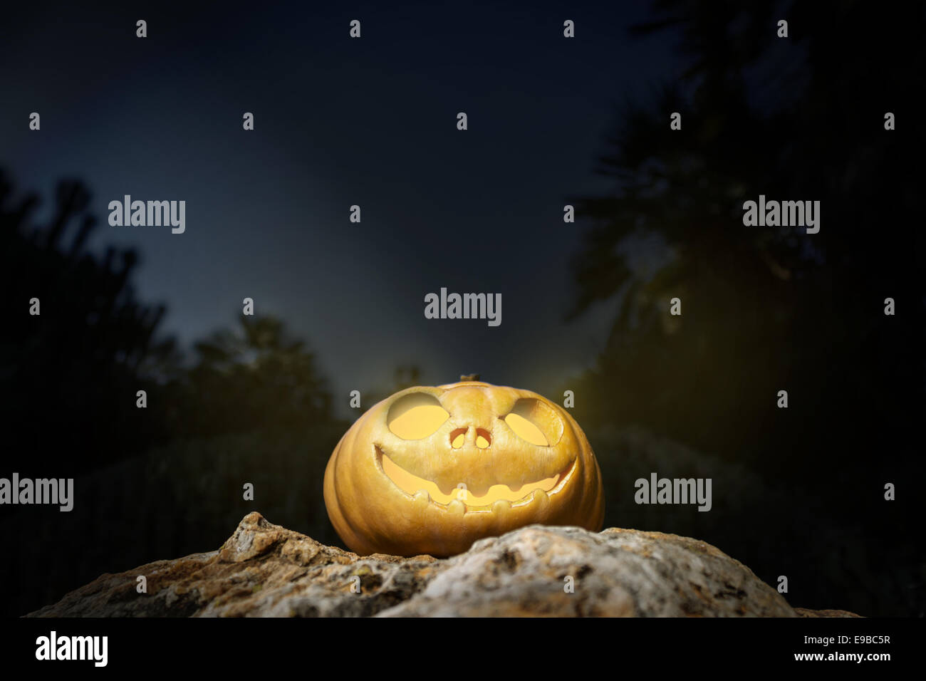Halloween scary pumpkin jack-o-lantern with a smile on a rock from ...