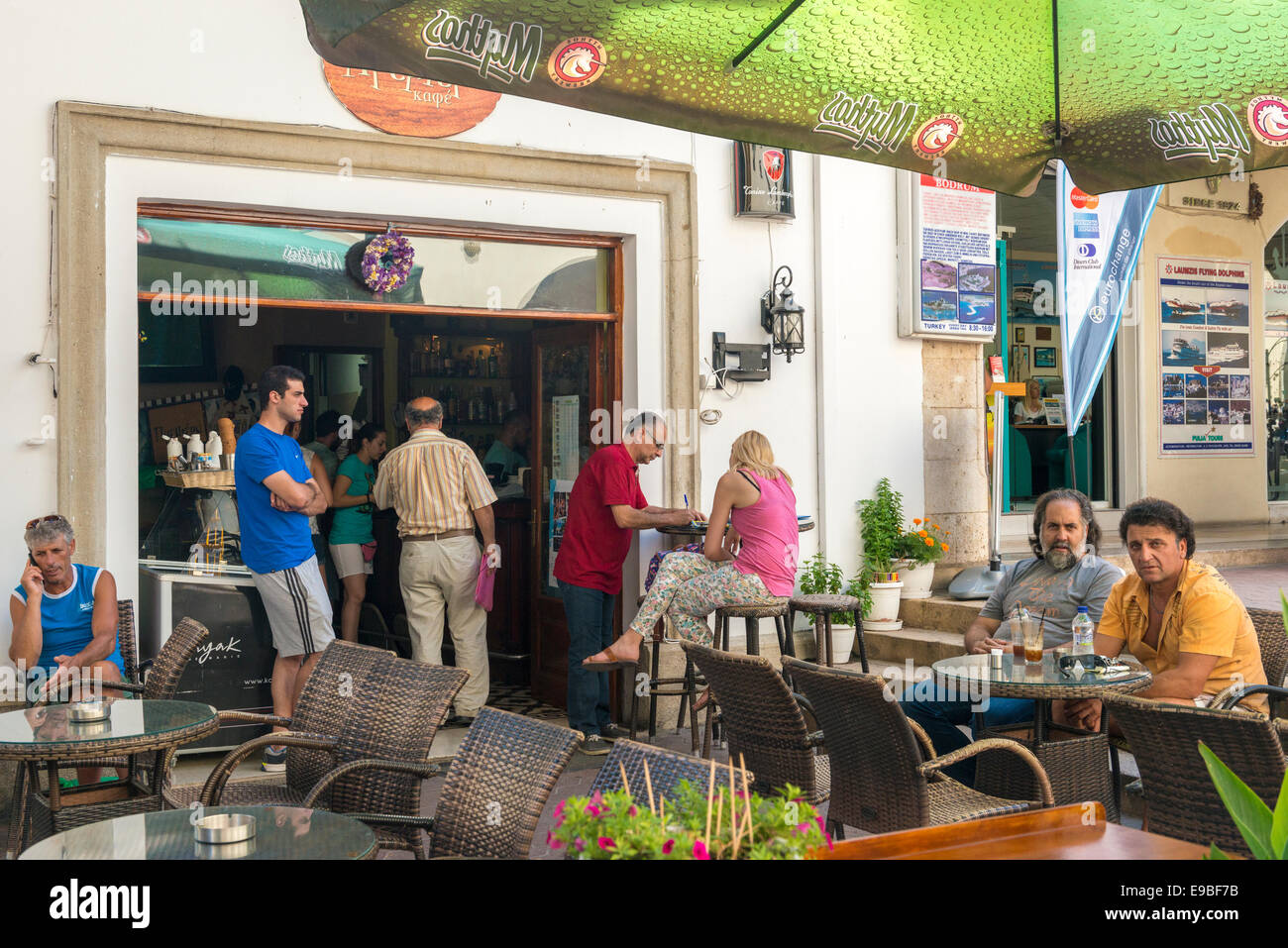 Greeks in a street café, Kos, island of Kos, Greece - Stock Image
