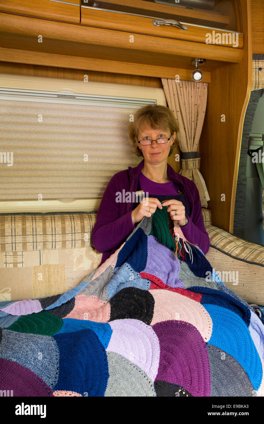 Sarah Chapman with Hand Knitted Blanket; Motorhome; UK - Stock Image