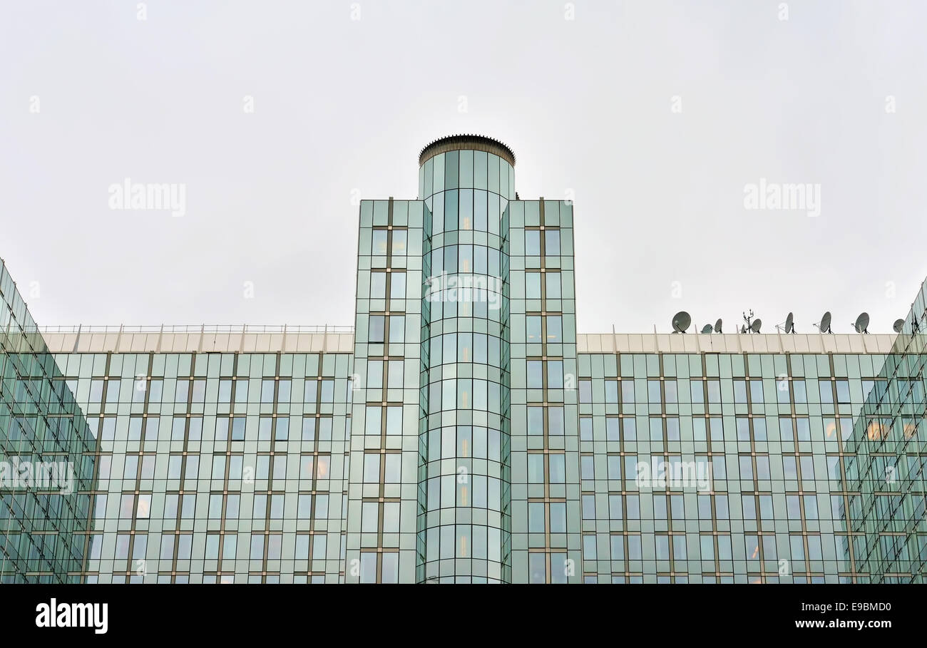 BRUSSELS, BELGIUM-OCTOBER 23, 2014: Symmetry of modern building of the European Parliament in Brussels - Stock Image