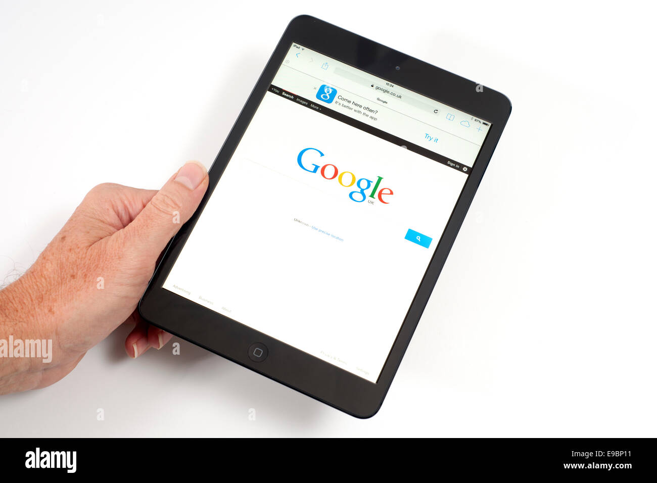 iPad mini with Google search engine page on screen - Stock Image