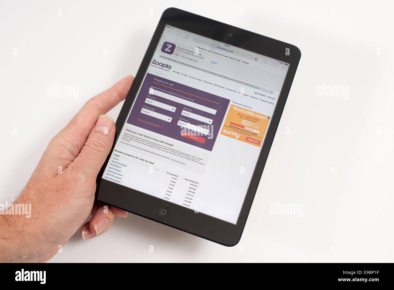 iPad mini with Zoopla property search engine on screen - Stock Image