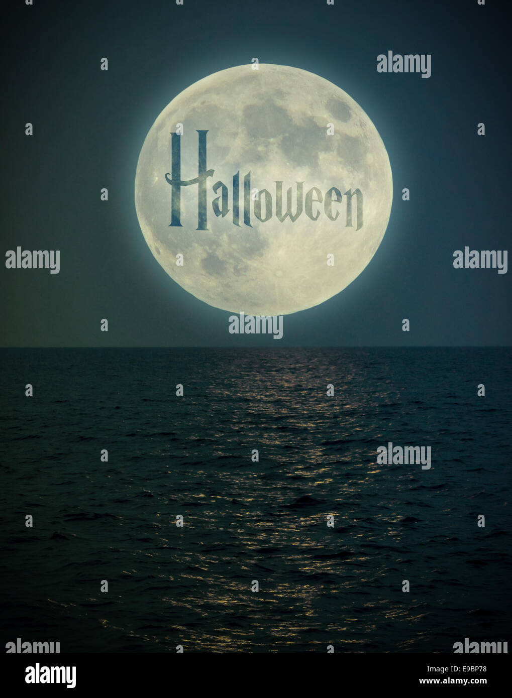 Halloween full super moon under the sea getting the light on water - Stock Image