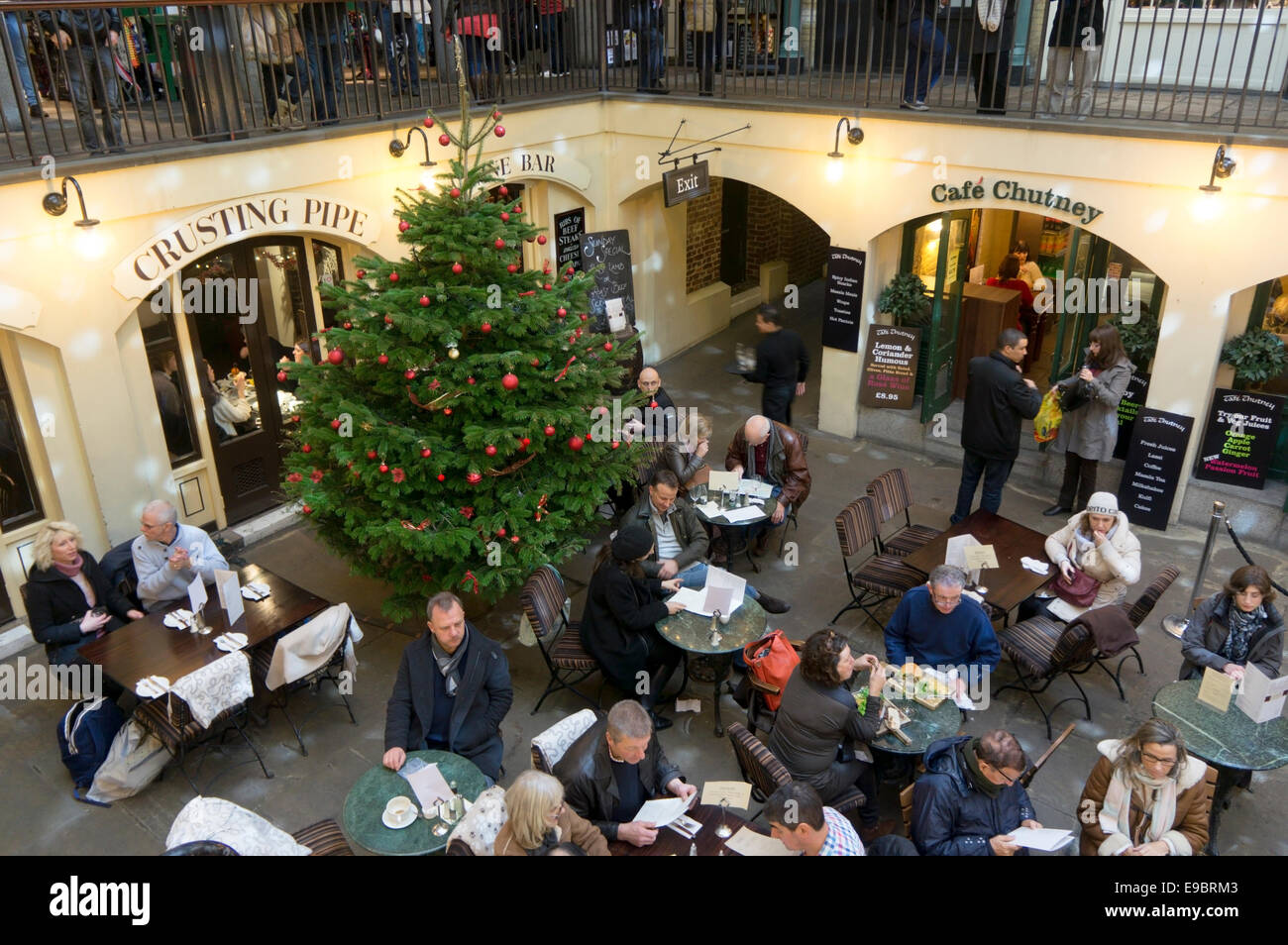 Christmas shoppers at Covent Garden in central London. - Stock Image