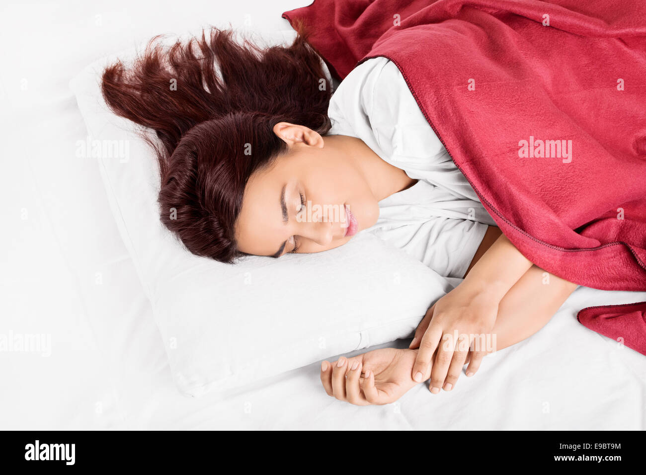 Beautiful girl sleeping, making an impression she's dreaming something nice - Stock Image
