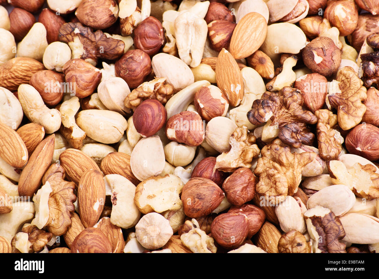 Mixture of almonds, hazelnuts, walnuts, cashews and pistachios. - Stock Image