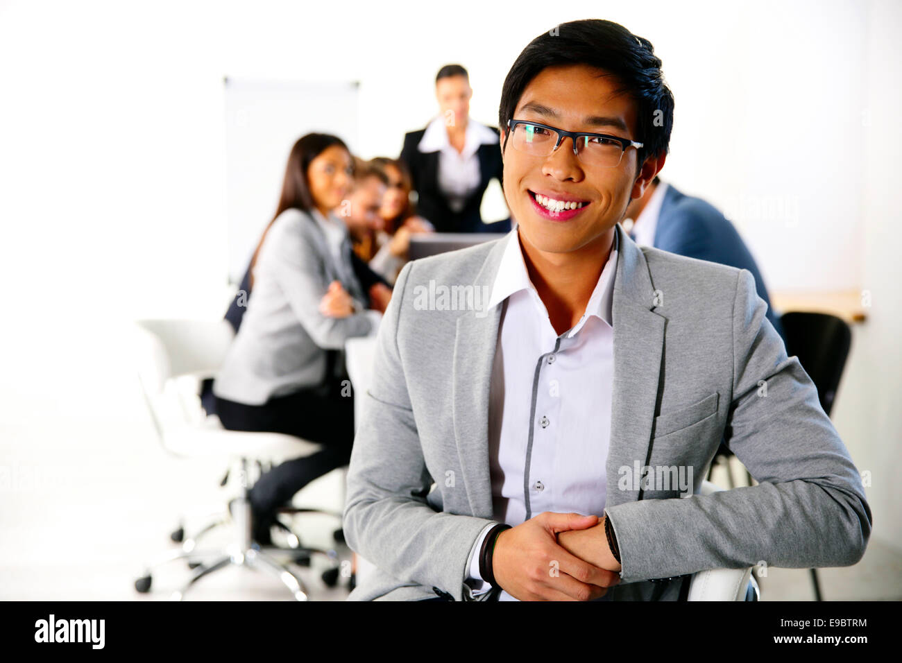 Businessman sitting on the office chair in front of business meeting Stock Photo