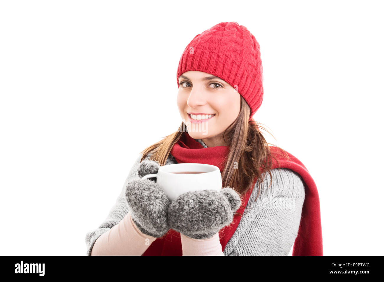 acd6b0b09c56 Beautiful girl in winter clothes holding a hot cup of tea isolated ...