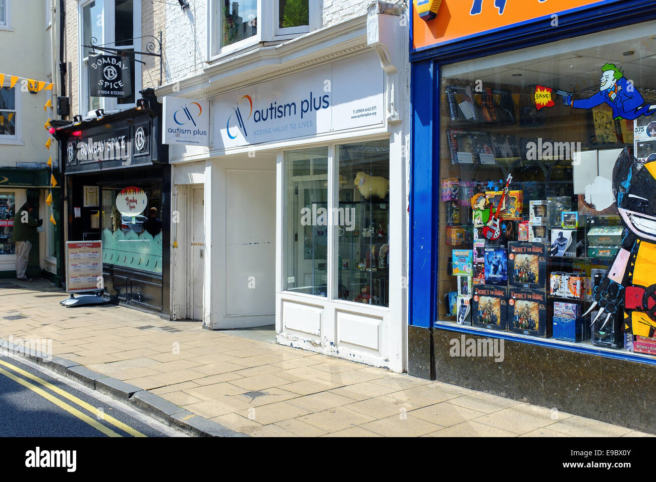 'Autism Plus' - a charity shop front in central York. Storefront. - Stock Image