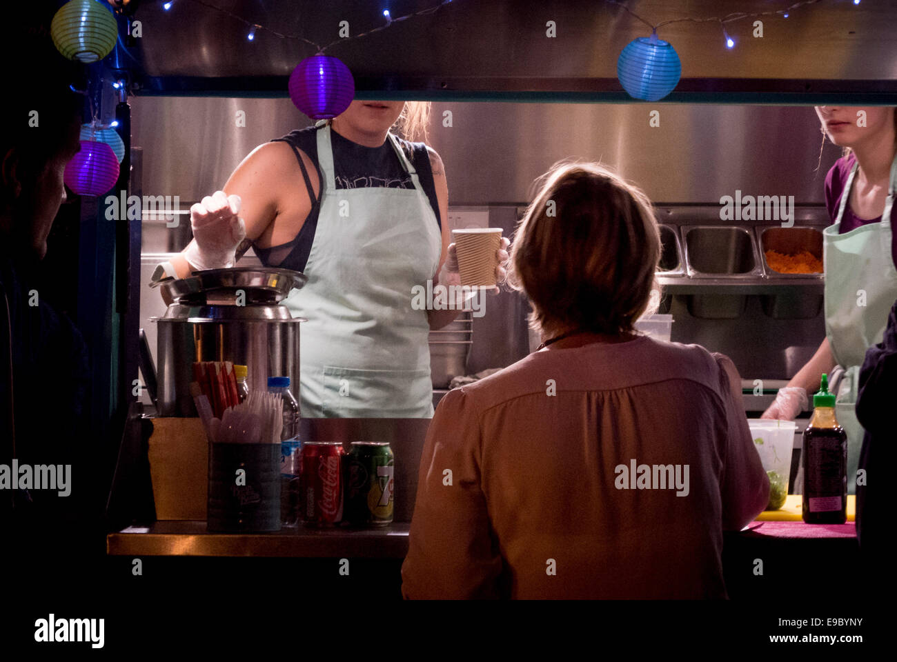 Outdoor catering stall serving hot drinks at night. - Stock Image