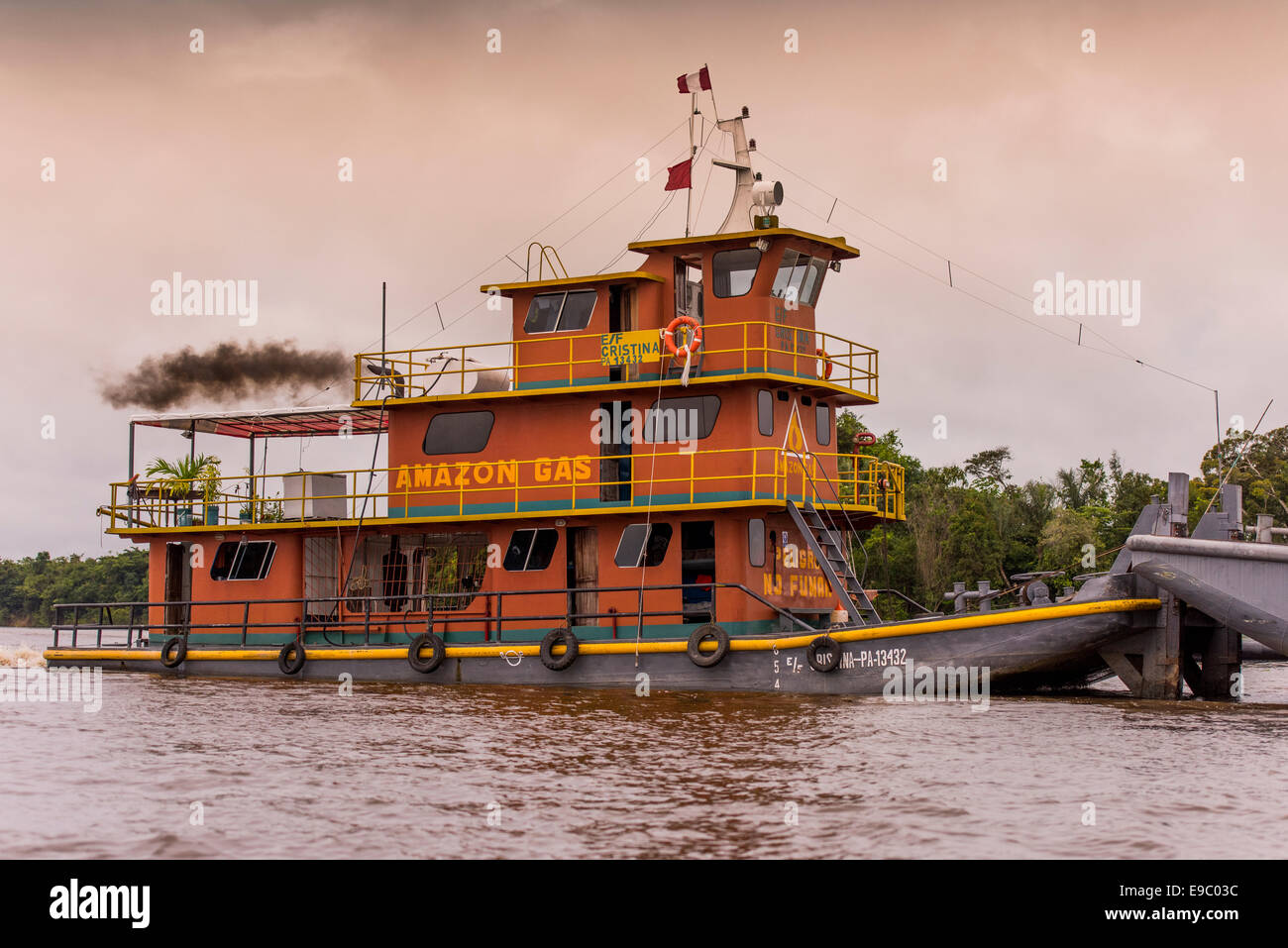 Amazon Gas Tug boat pushing a gas tanker on the Rio Nanay where it joins the Amazon - Stock Image