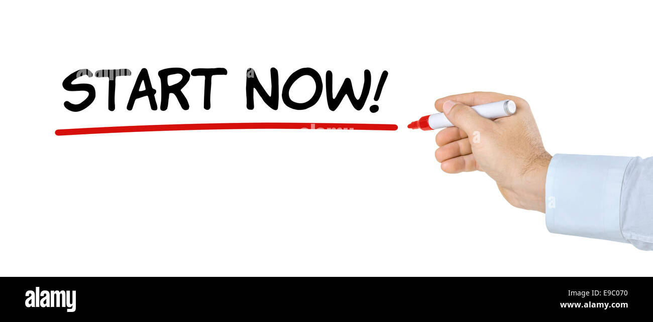 Hand with pen writing Start now - Stock Image