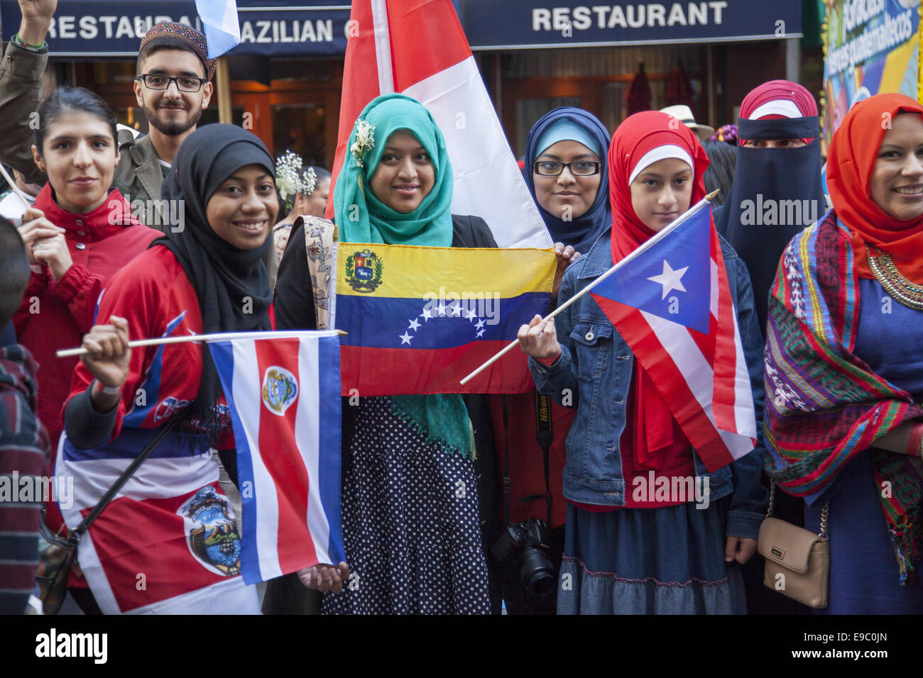 Hispanic Day Parade on 5th Avenue in NYC. Hispanic Muslims representing various Latin countries. - Stock Image