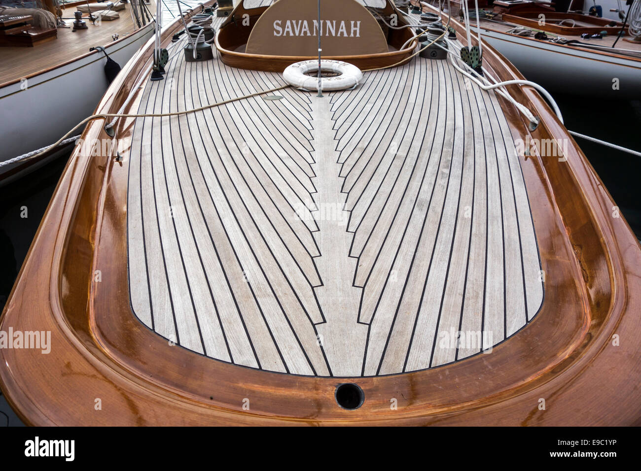 Wooden deck of sailing yacht in harbour - Stock Image