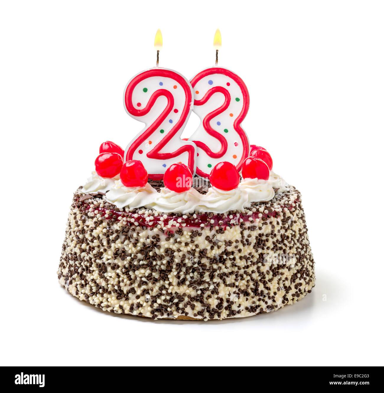 Birthday cake with burning candle number 23 - Stock Image