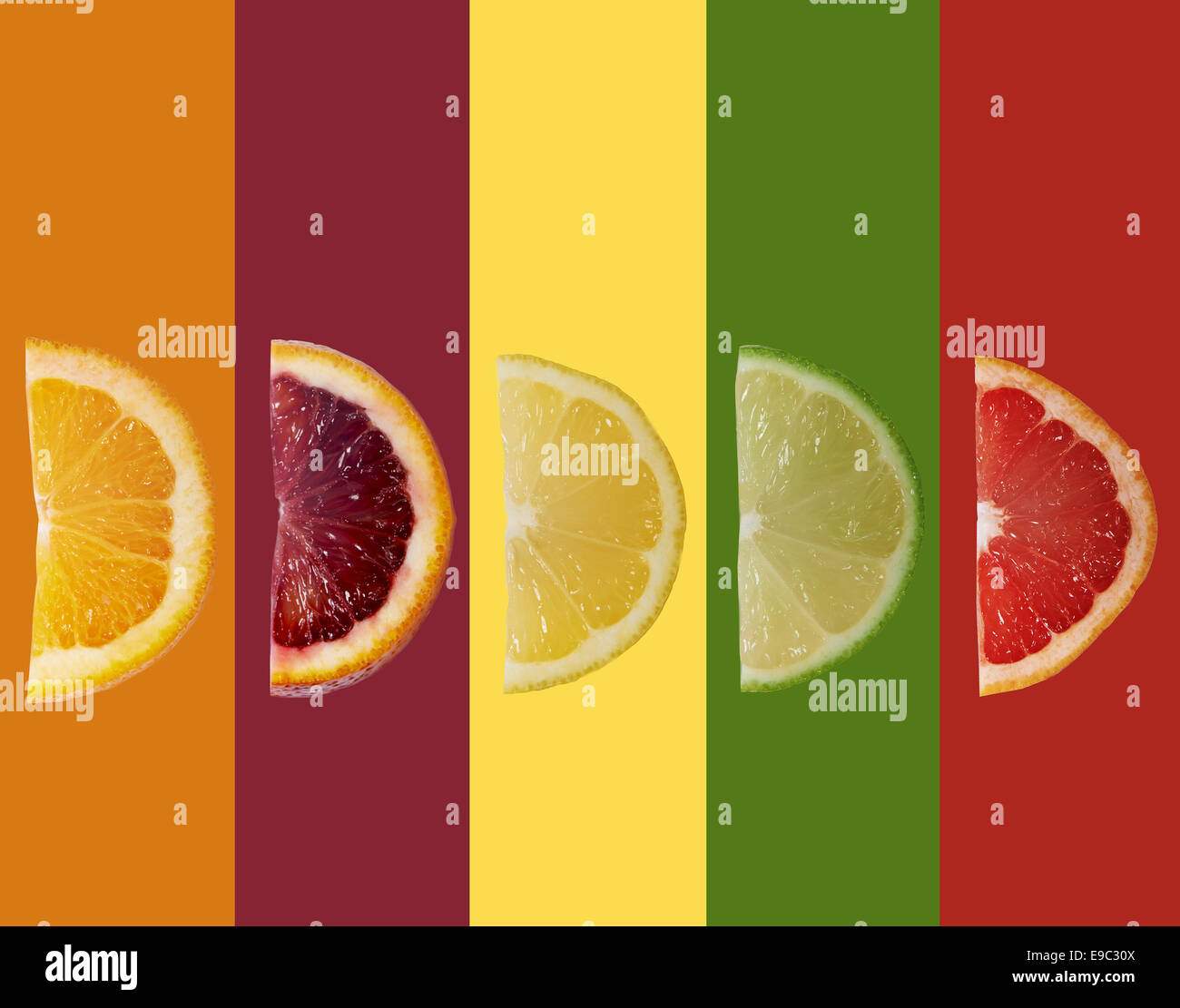 Different citrus fruits lined up in a colorful arrangement - Stock Image