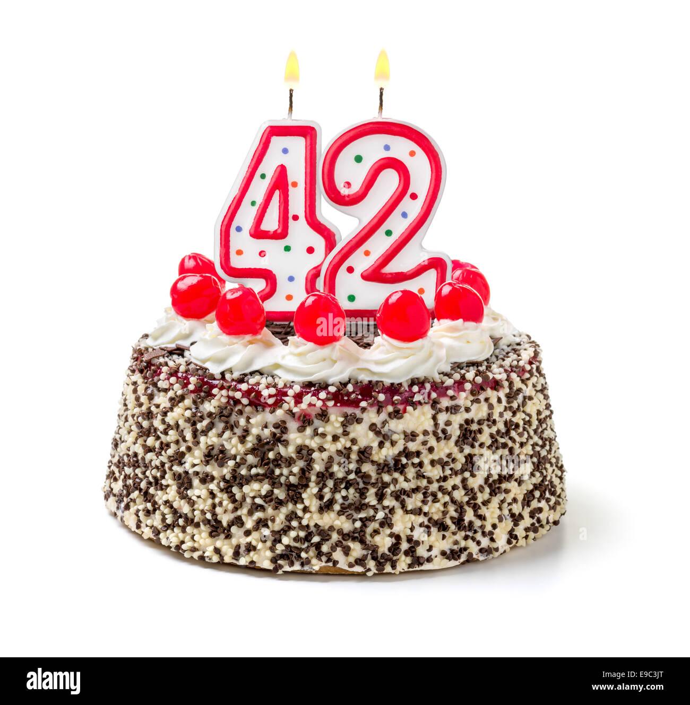 Birthday cake with burning candle number 42 - Stock Image