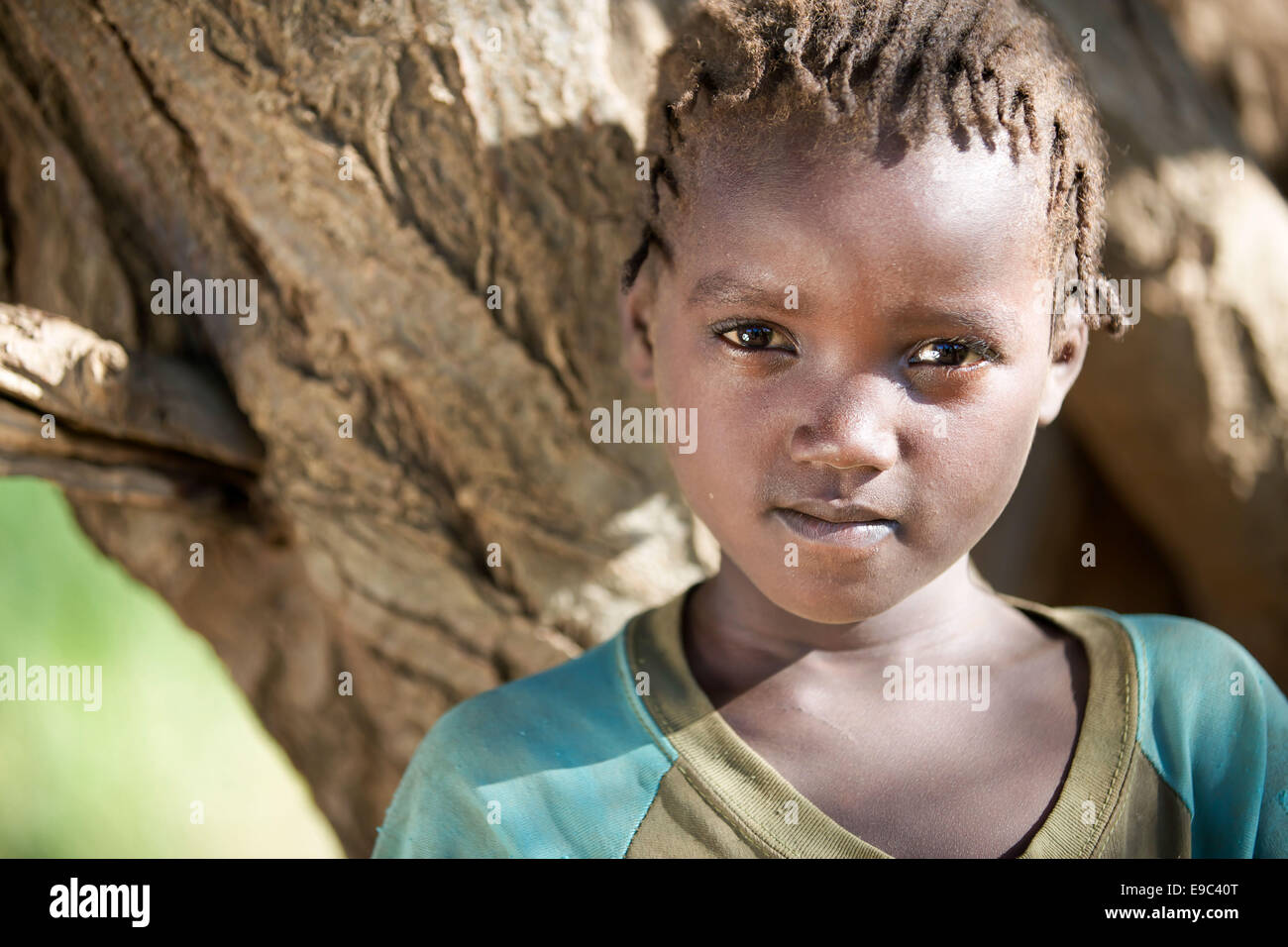 Nyangatom Girl in Omo Valley, Ethiopia 15 May 2014. The Nyangatom also known as Bume are nomadic, residing in mobile Stock Photo