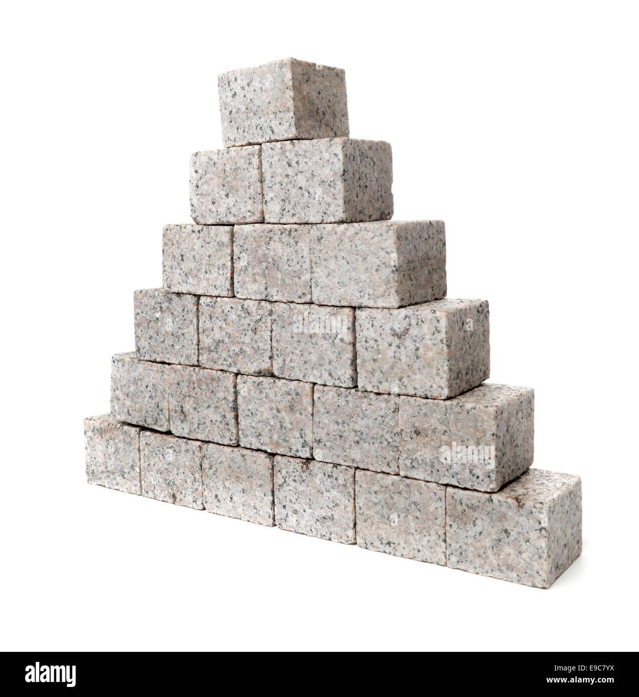 Pyramid made of small granite rock blocks. - Stock Image