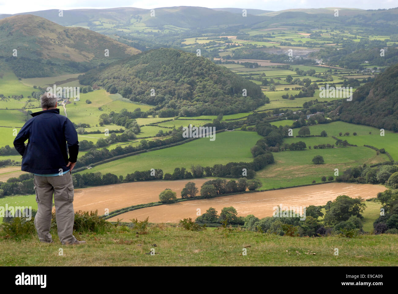 A man admires the landscape on the Herefordshire/Powys border near Kington. - Stock Image