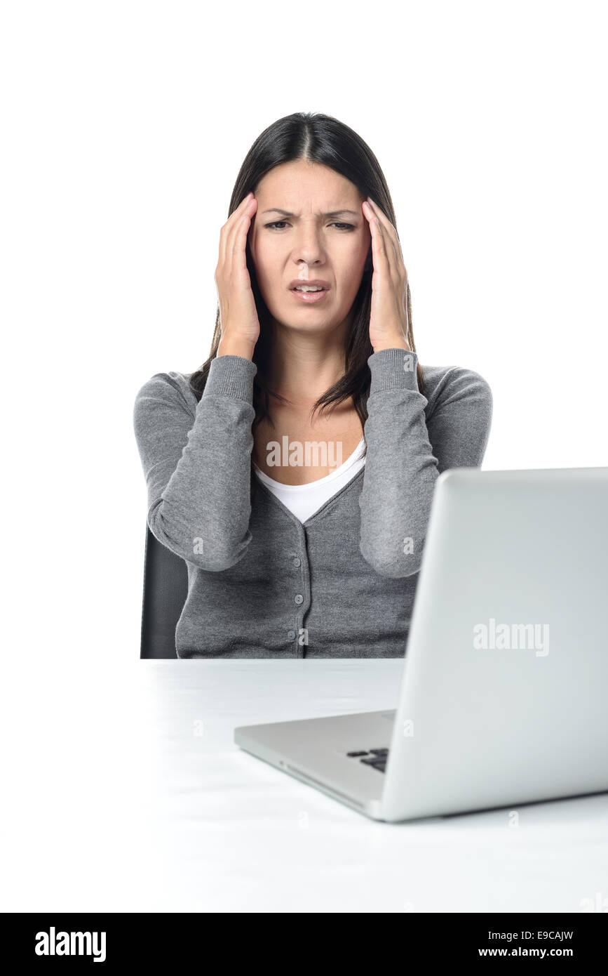 Young Woman Suffers from headache or migraine Facing Laptop on the Table. isolated on White Background - Stock Image