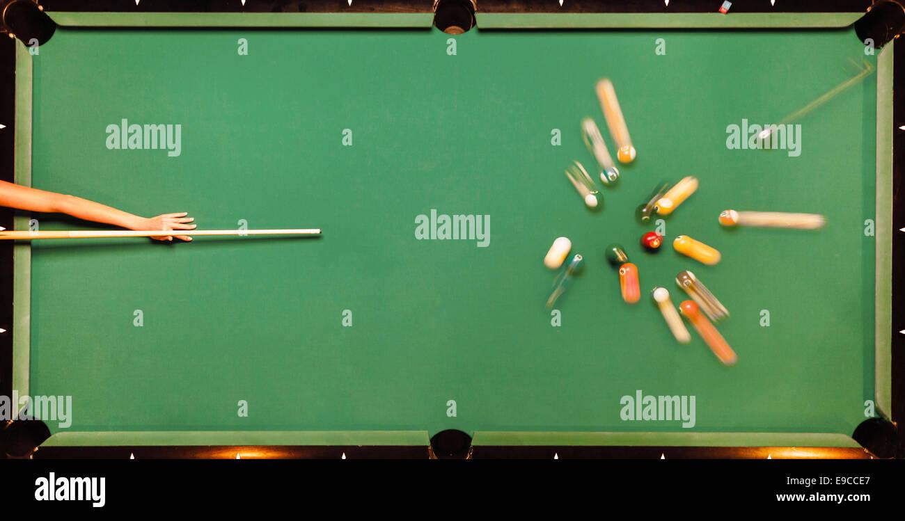 Breaking Pool Balls on green table - Stock Image