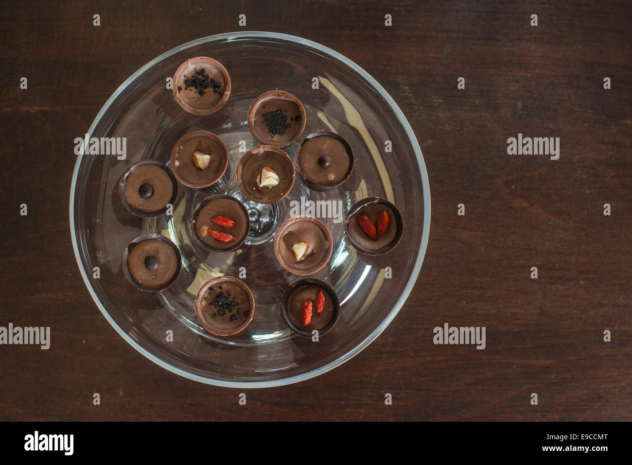 Chocolates in a luxurious glass dish. Various sweets - Stock Image