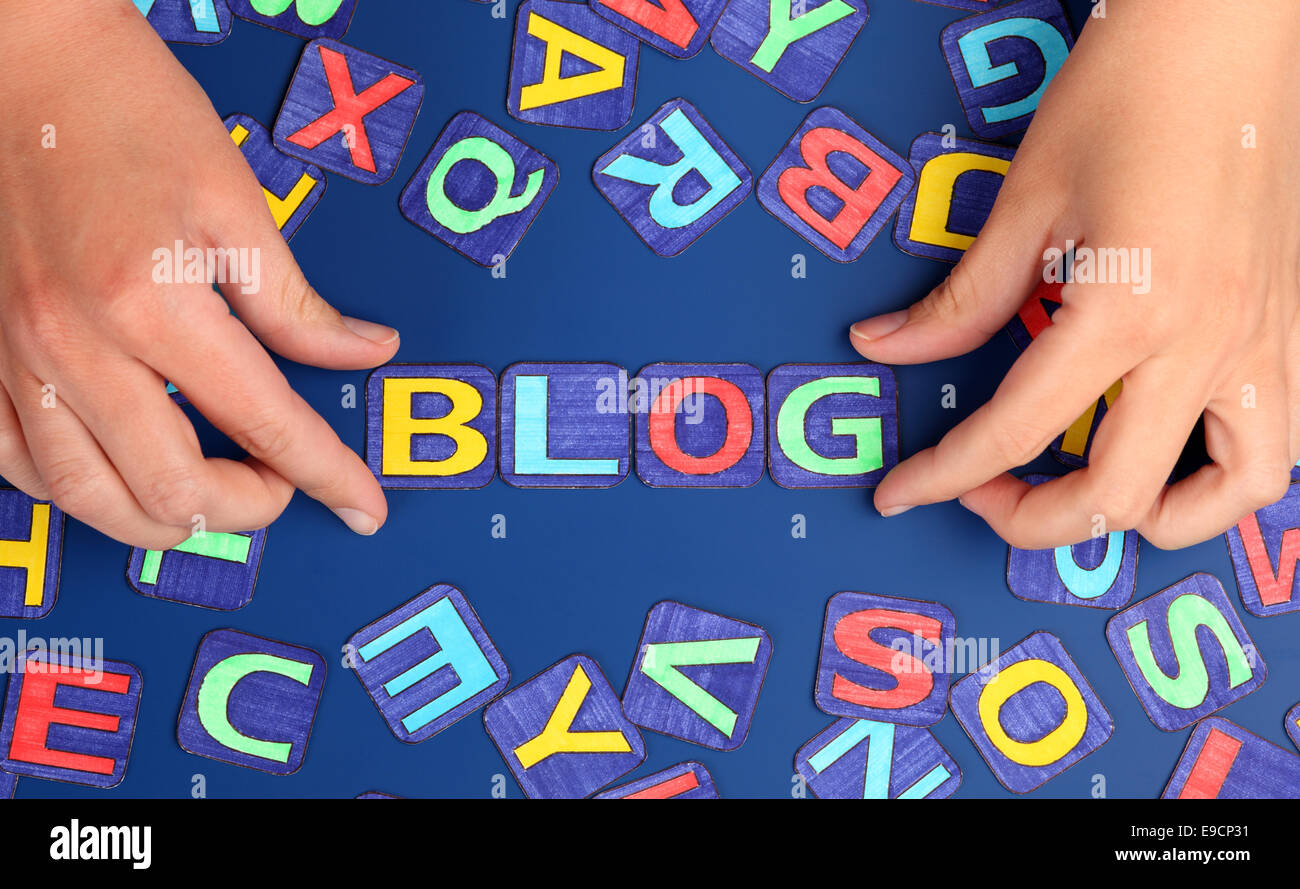 Word 'Blog' spell out on blue background with woman's hands and letters. Letters drawn by me. - Stock Image