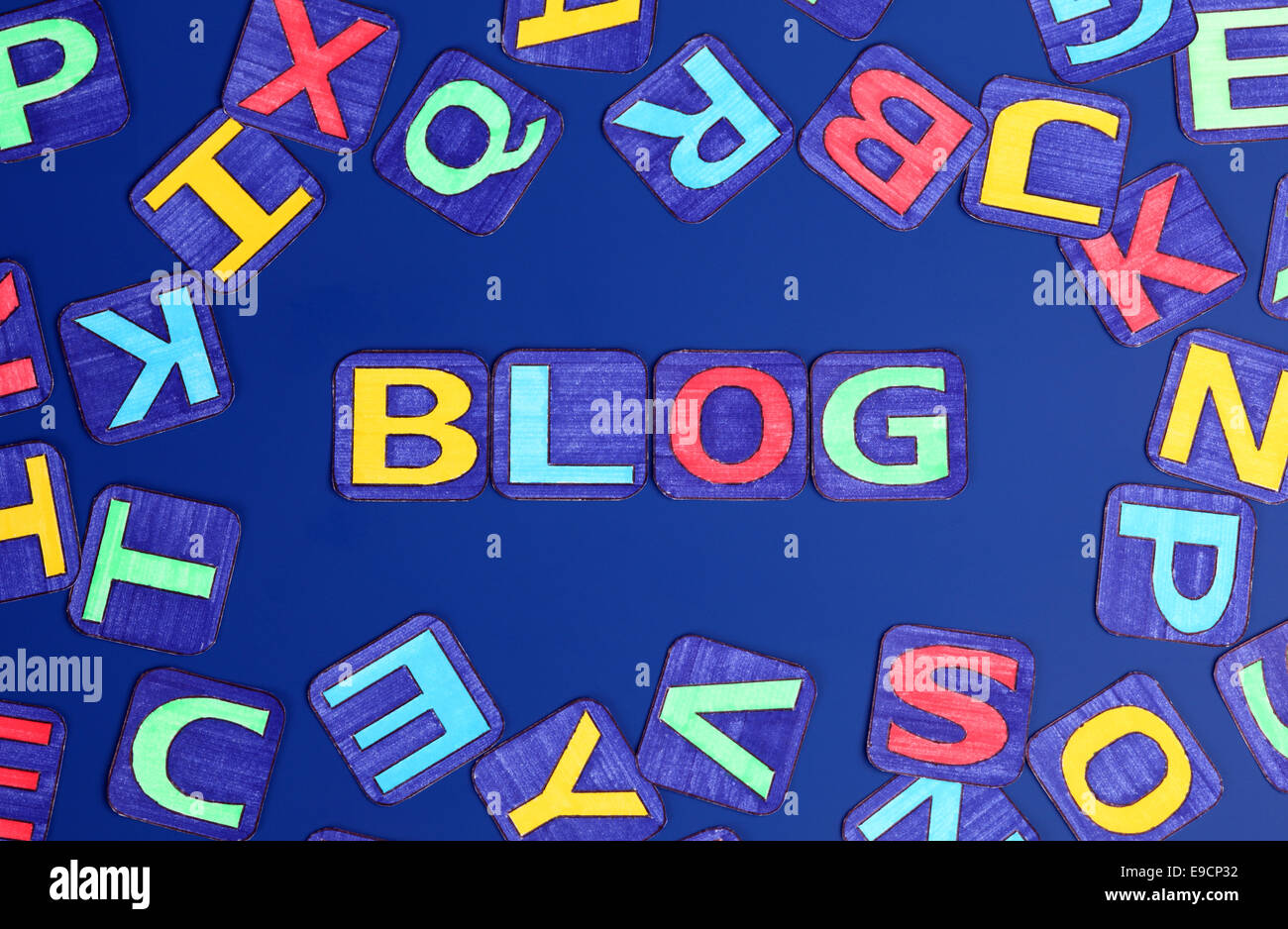 Word 'Blog' spell out on blue background with letters. Letters drawn by me. - Stock Image