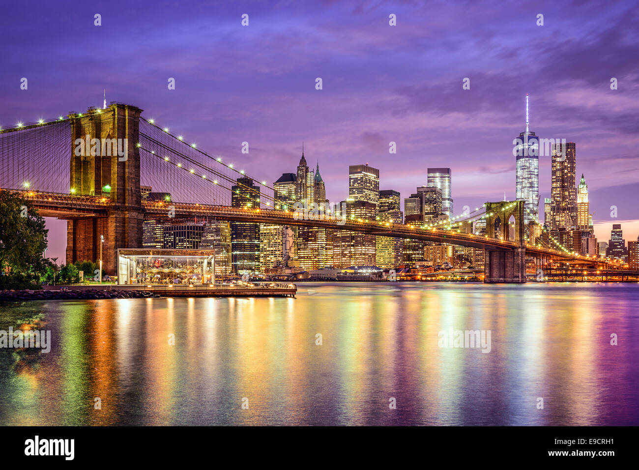 New York, New York, USA city skyline with the Brooklyn Bridge and Manhattan Financial District over the East River. Stock Photo