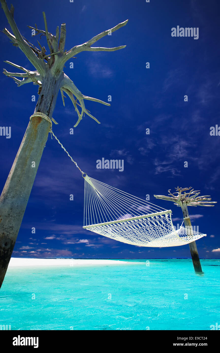 Hammock in the middle of tropical lagoon in Maldives - Stock Image