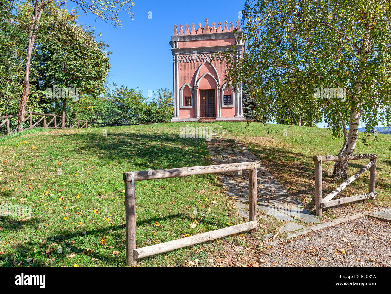 Rural chapel of San Pietro on green lawn near town of Barolo in Piedmont, Northern Italy. - Stock Image