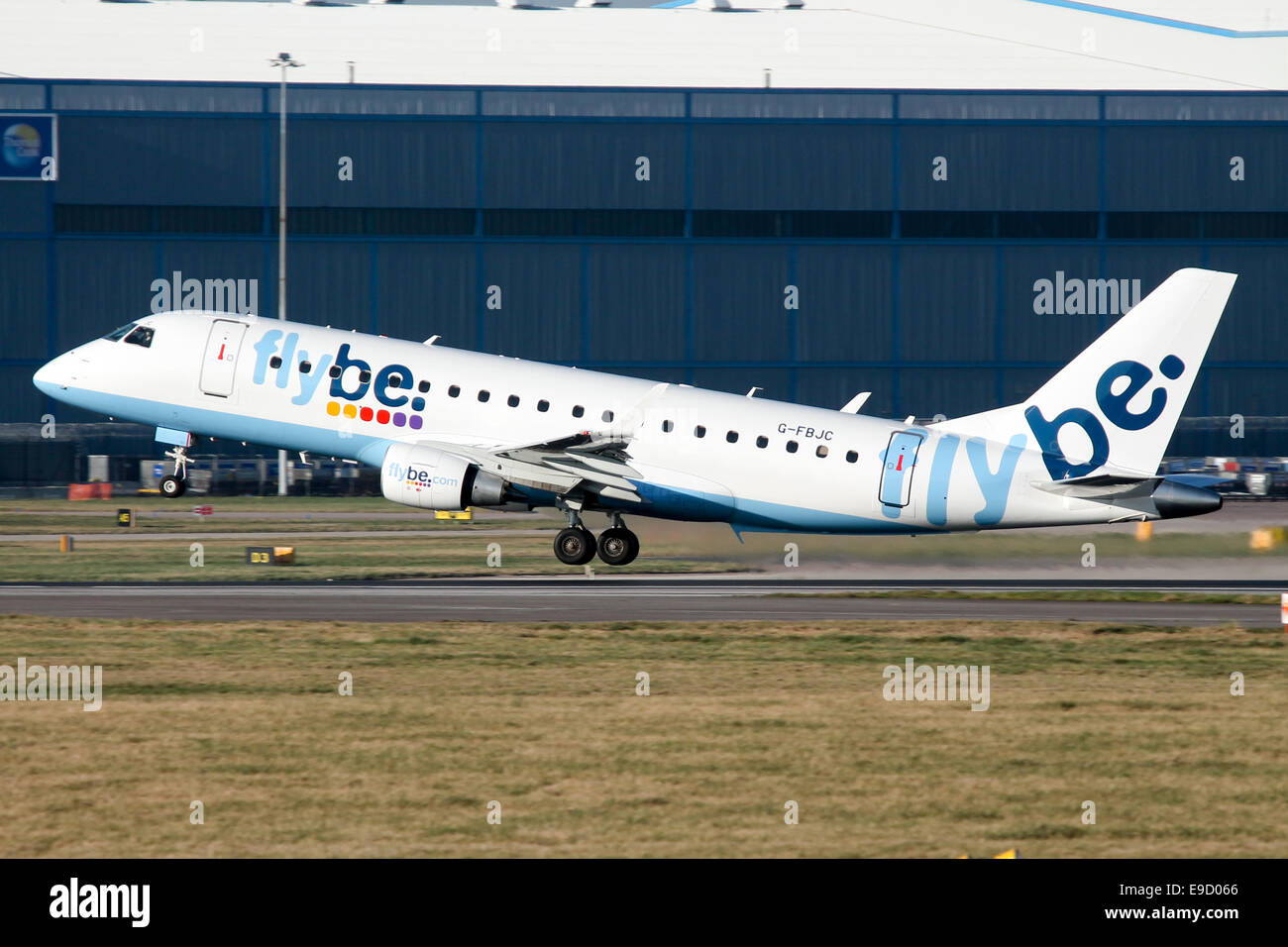 FlyBe Emraber 175 rotates from runway 23R at Manchester airport. - Stock Image