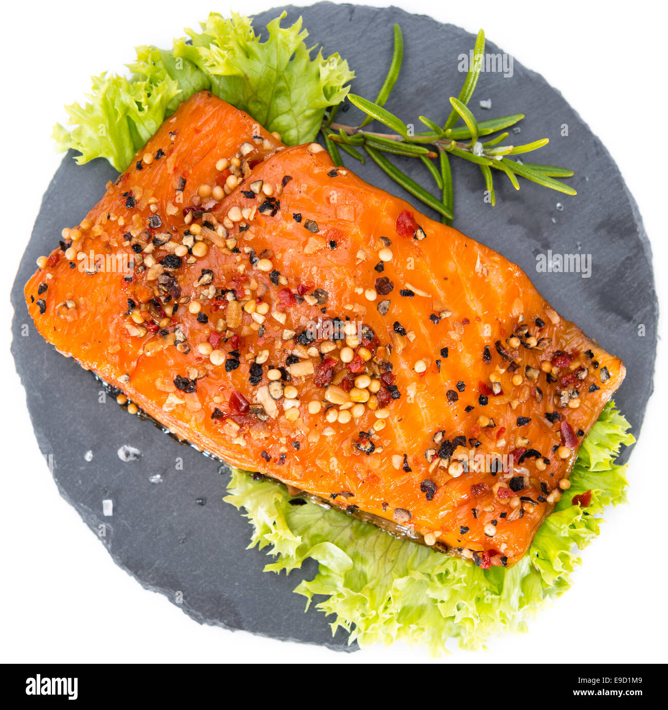 Smoked Salmon marinated with spices isolated on pure white background - Stock Image