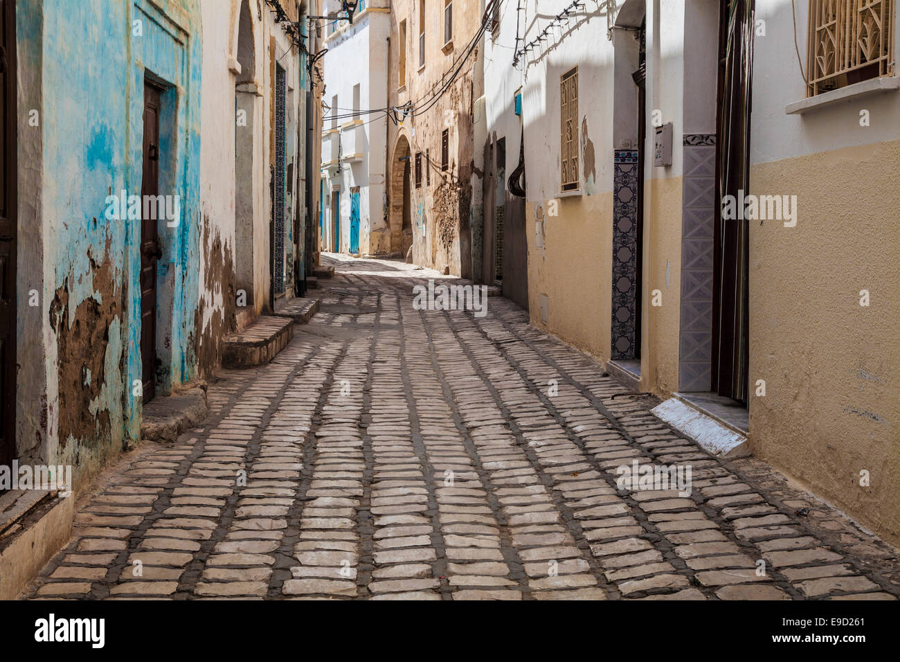 Narrow cobbled sidestreet  in the medina in Sousse,Tunisia. Stock Photo