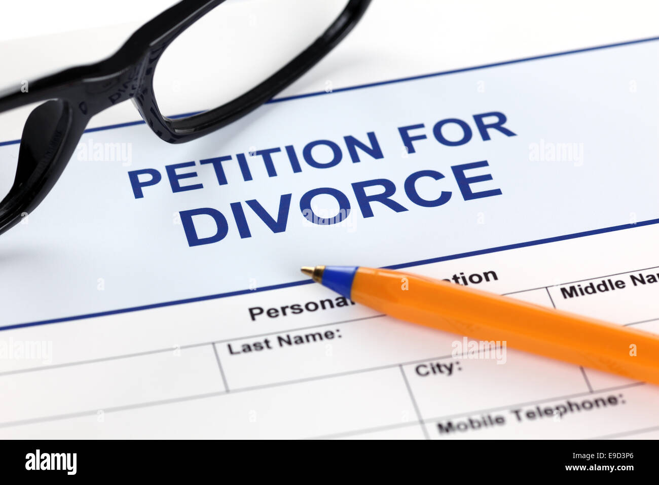 Petition for Divorce with glasses and ballpoint pen. - Stock Image