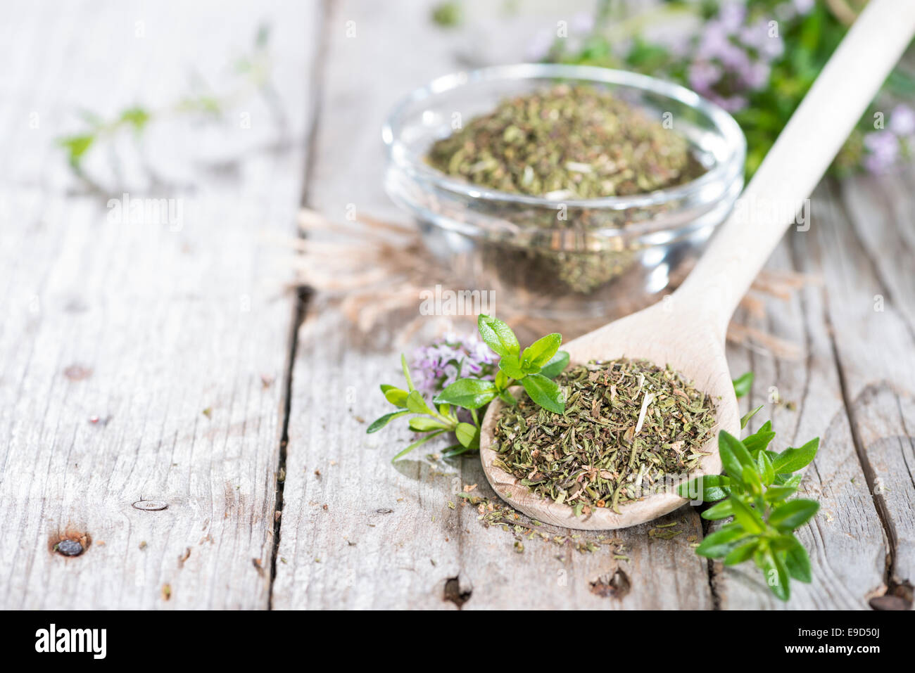 Portion of dried Winter Savory on a wooden spoon - Stock Image