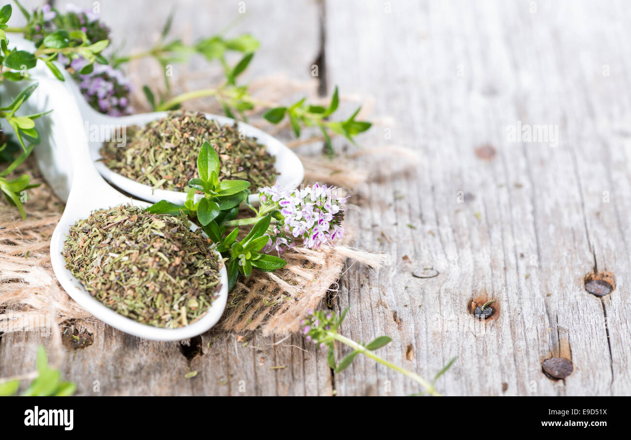 Portion of dried Winter Savory on wooden background - Stock Image