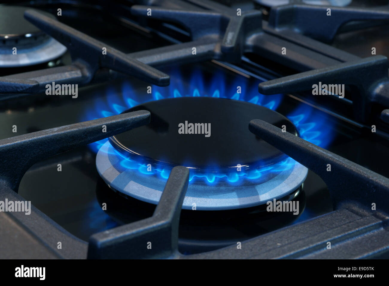 Gas burner on a domestic cooker or stove - Stock Image