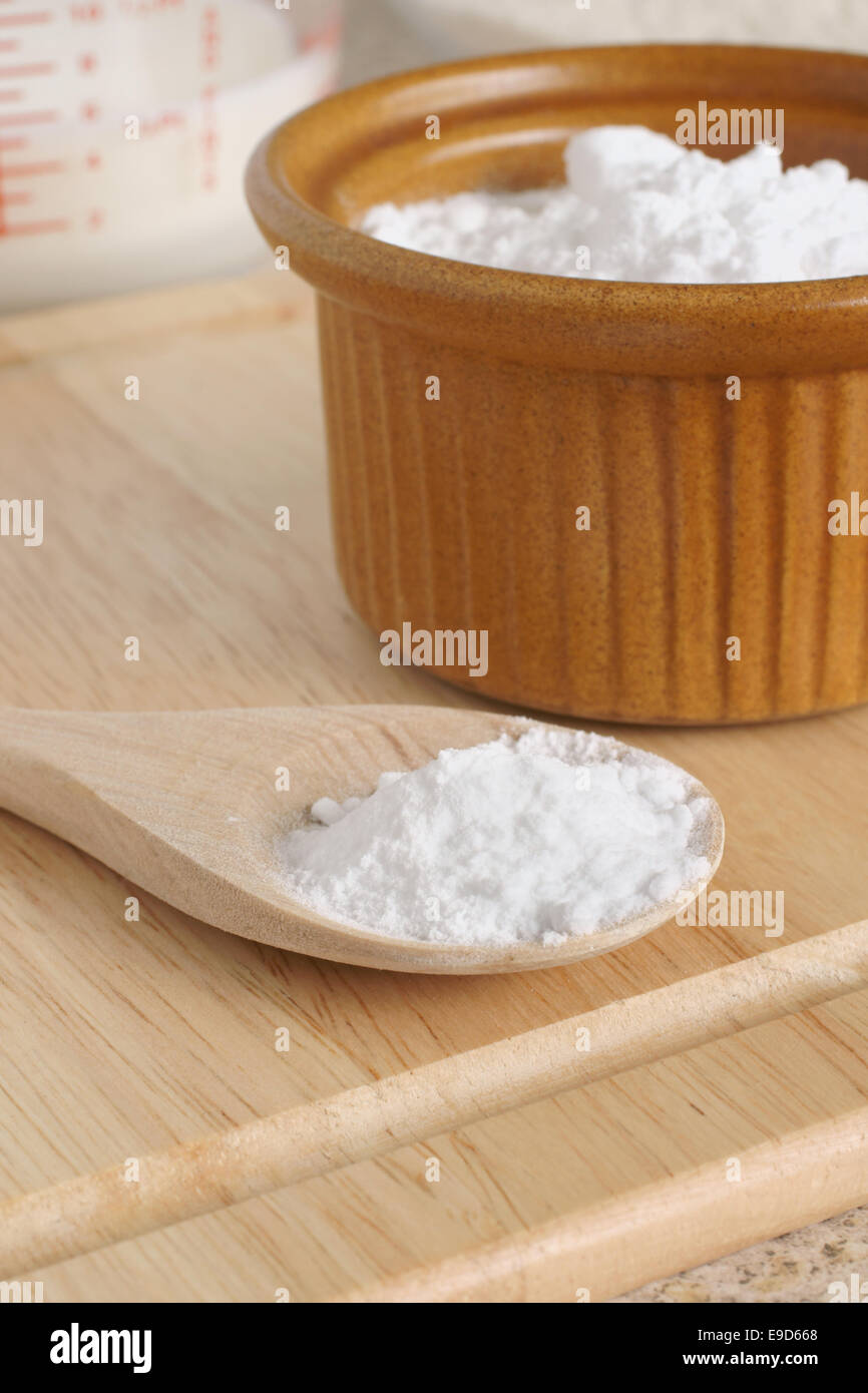 Baking Soda or Sodium bicarbonate used in baking as a  leavening agent selective focus on the spoon - Stock Image