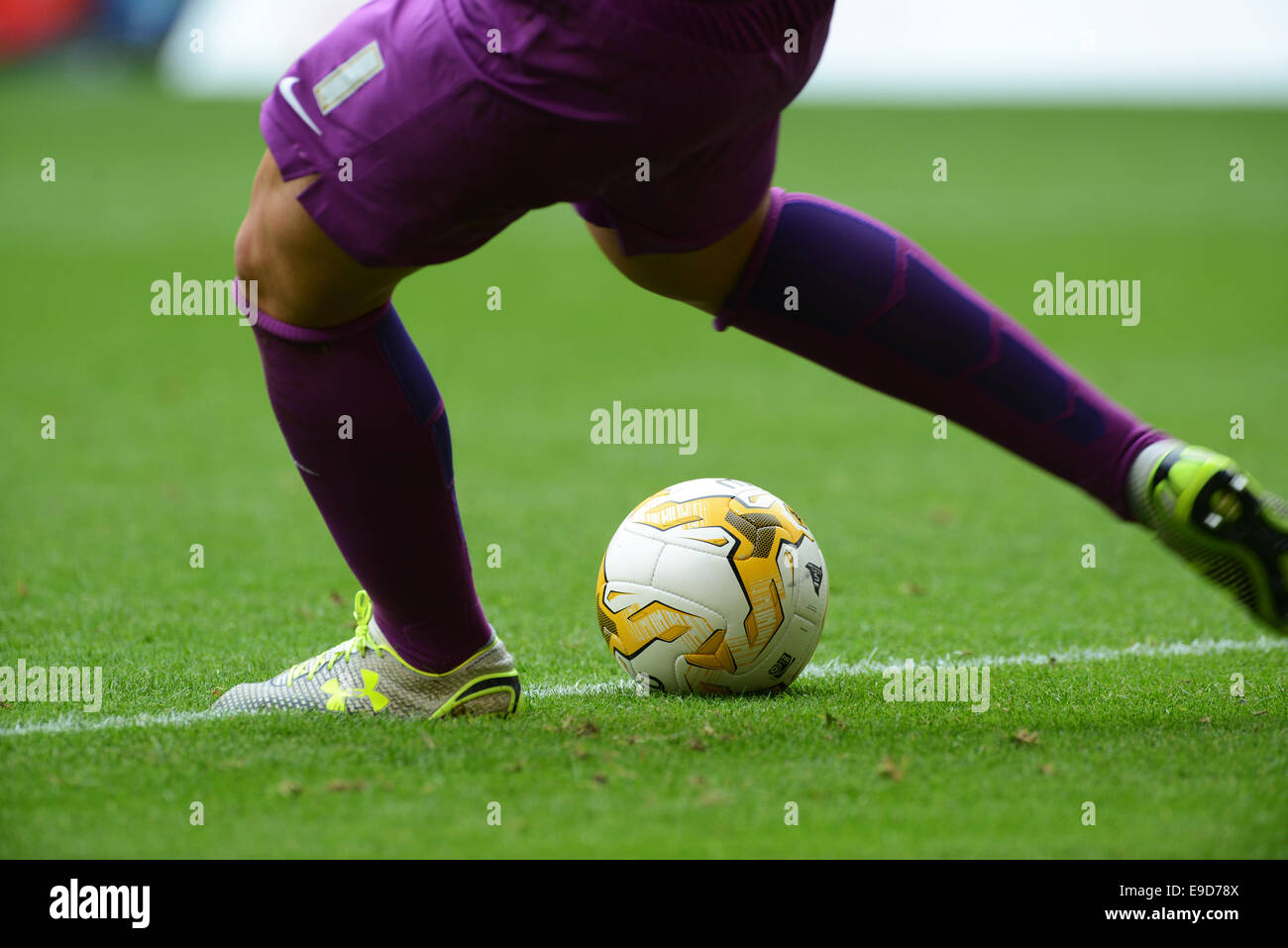 Footballer kicking professional Mitre football ball - Stock Image