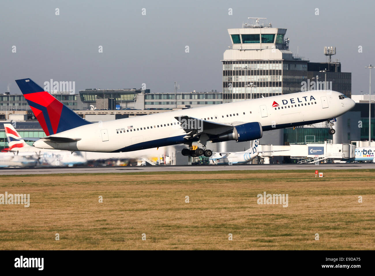 Delta Airlines Boeing 767-300 rotates from runway 05L at Manchester airport. - Stock Image