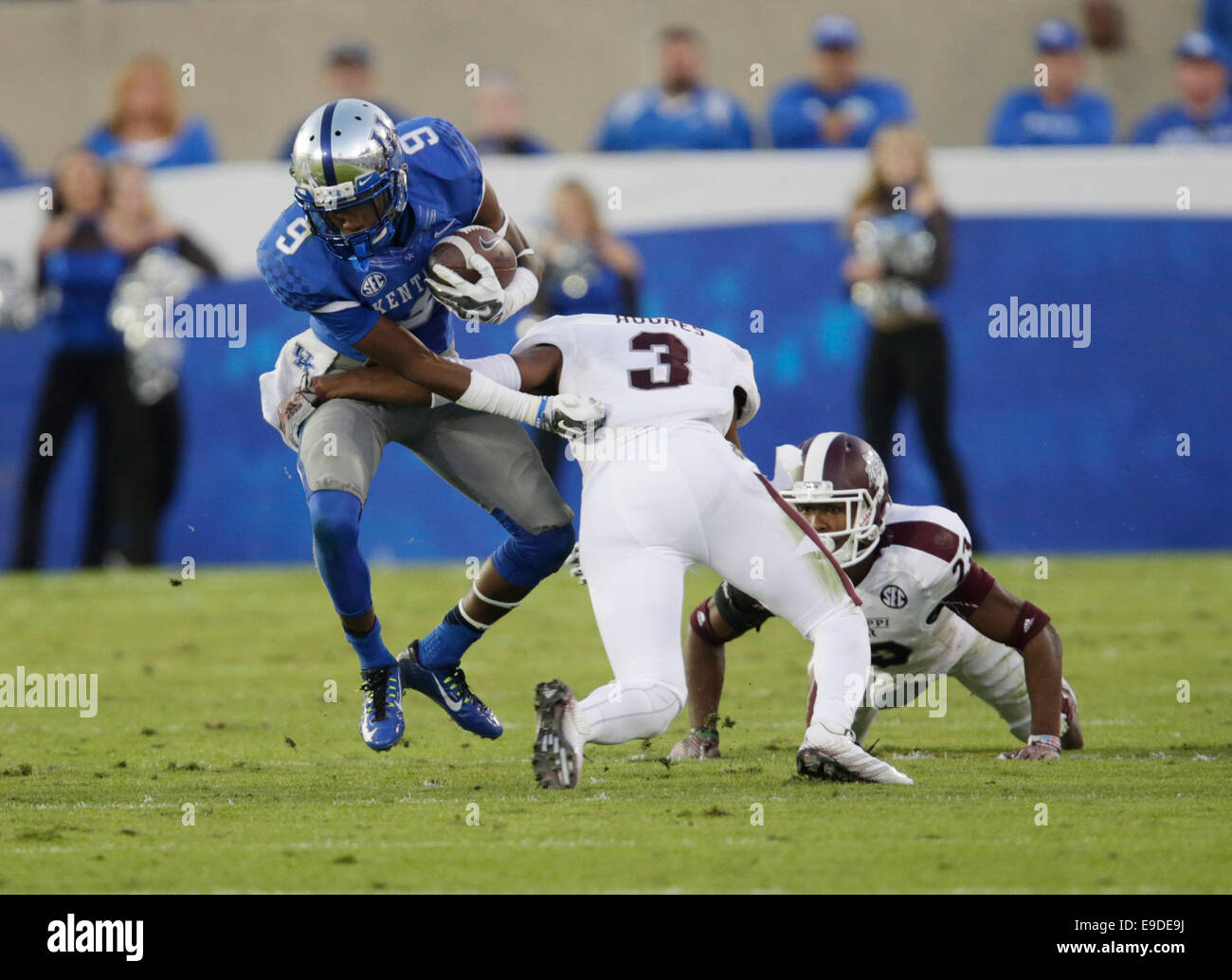 Oct. 25, 2014 - Lexington, Ky, US - Kentucky's Demarco Robinson (9) was tackled by Jay Hughes (3) in the fourth Stock Photo