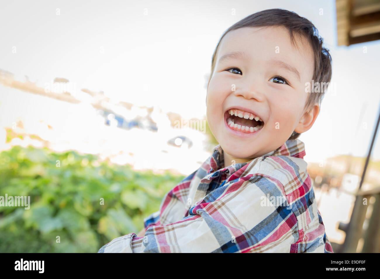 Cute Mixed Race Young Boy Having Fun Outside. - Stock Image