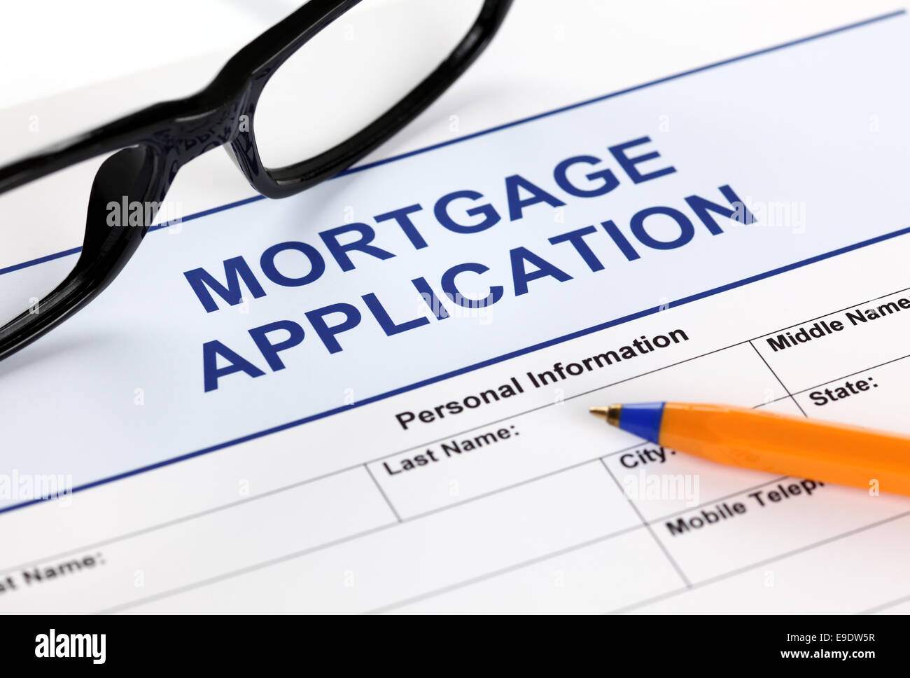 Mortgage application form with glasses and ballpoint pen. Stock Photo