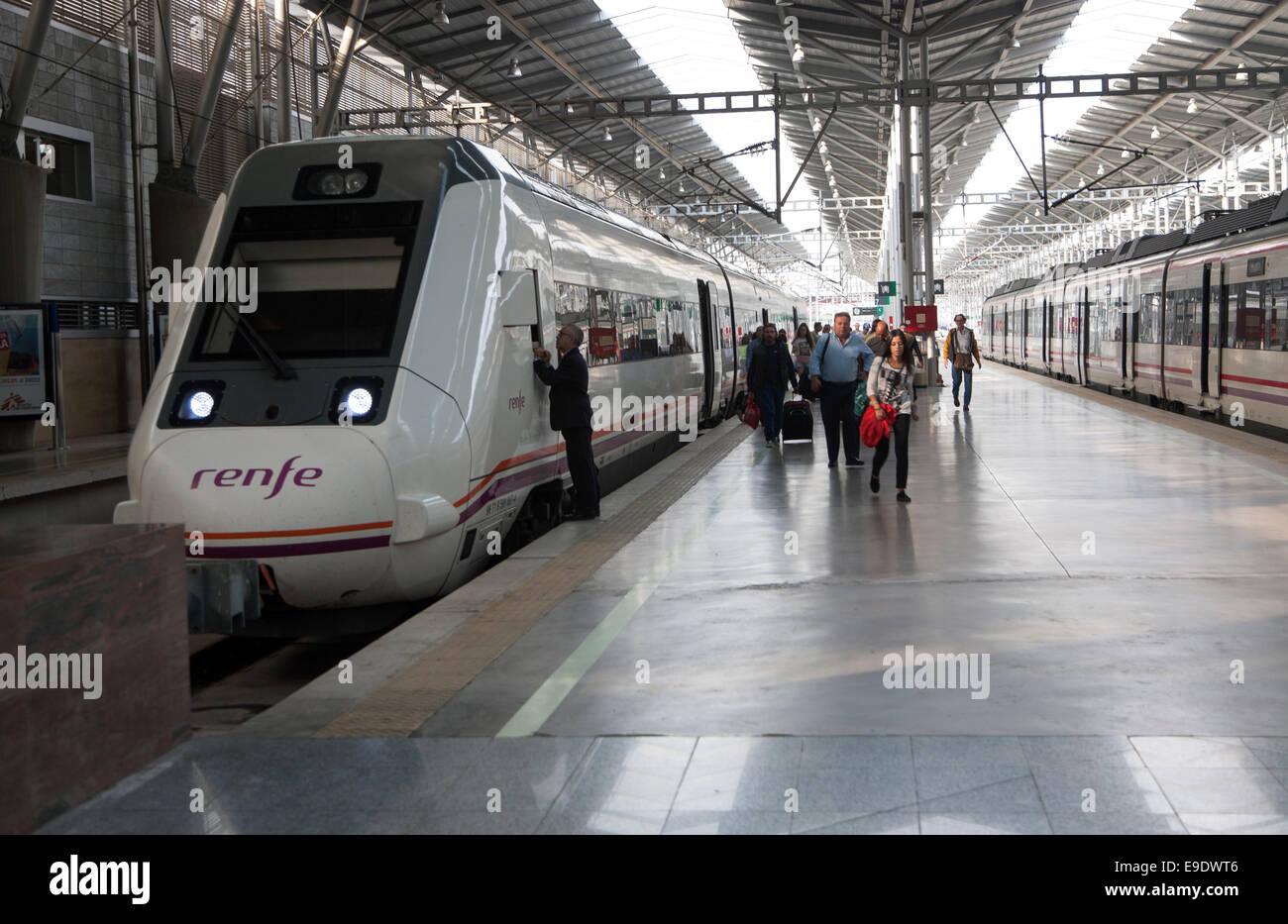 Train at platform inside María Zambrano railway station Malaga, Spain - Stock Image